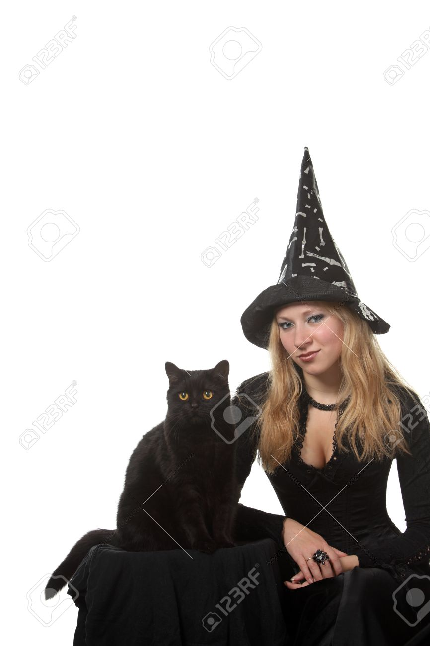 A Young Woman In A Witch Costume With A Black Cat Stock Photo ...
