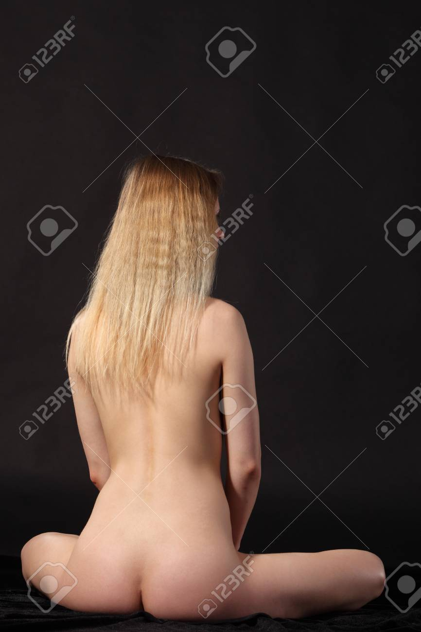 Young attractive naked woman. Studio shot Stock Photo - 9884288