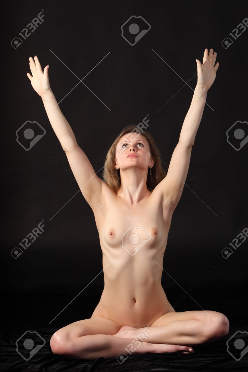 Young attractive naked woman sit in the lotos position Stock Photo - 9884286