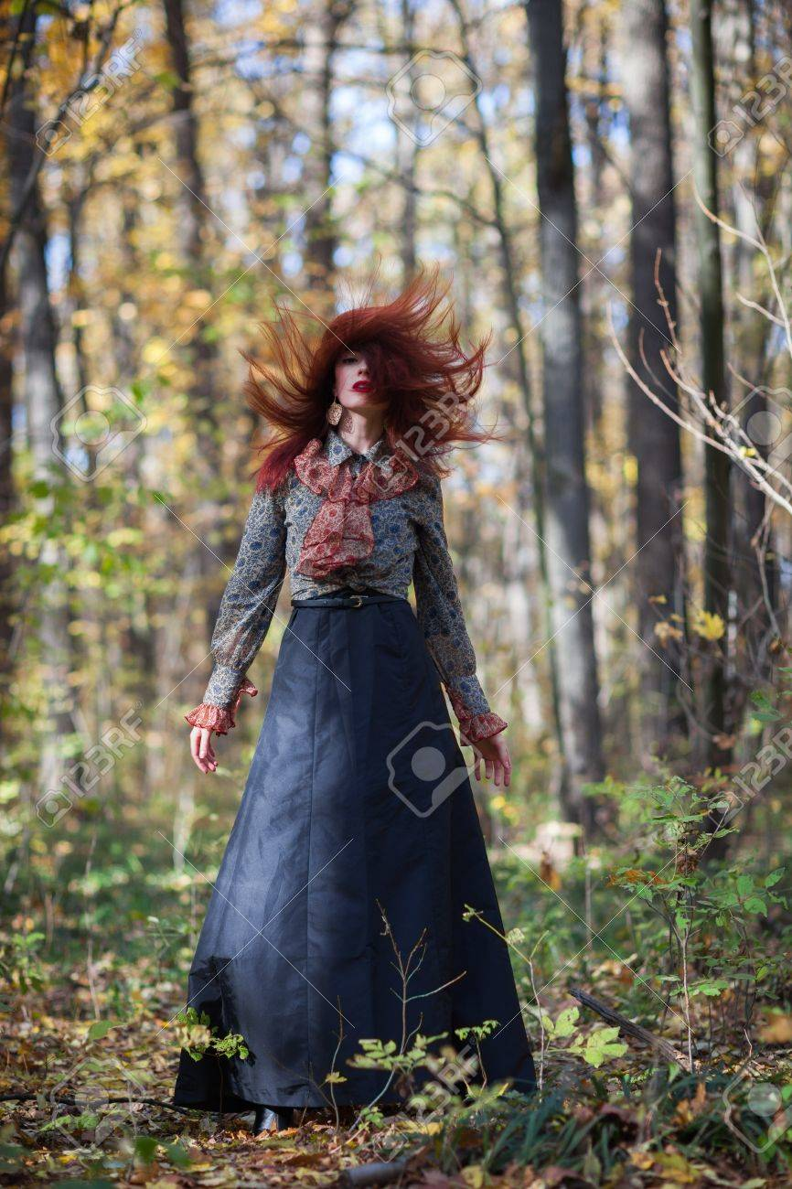 Young slim red autumn girl dance in autumn forest Stock Photo - 16494275