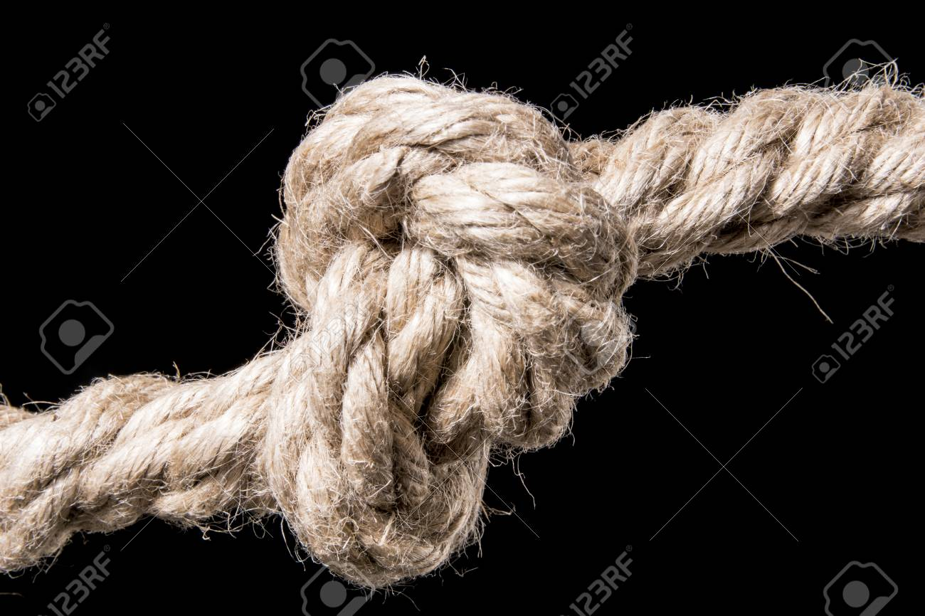 Rope knot isolated on a black background symbol for trust and rope knot isolated on a black background symbol for trust and faith and a metaphor biocorpaavc Choice Image