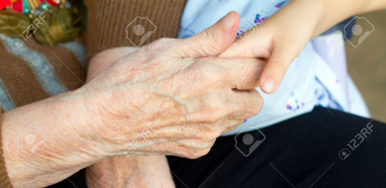 Grandmother holds the hand of his grandson Stock Photo - 13727865