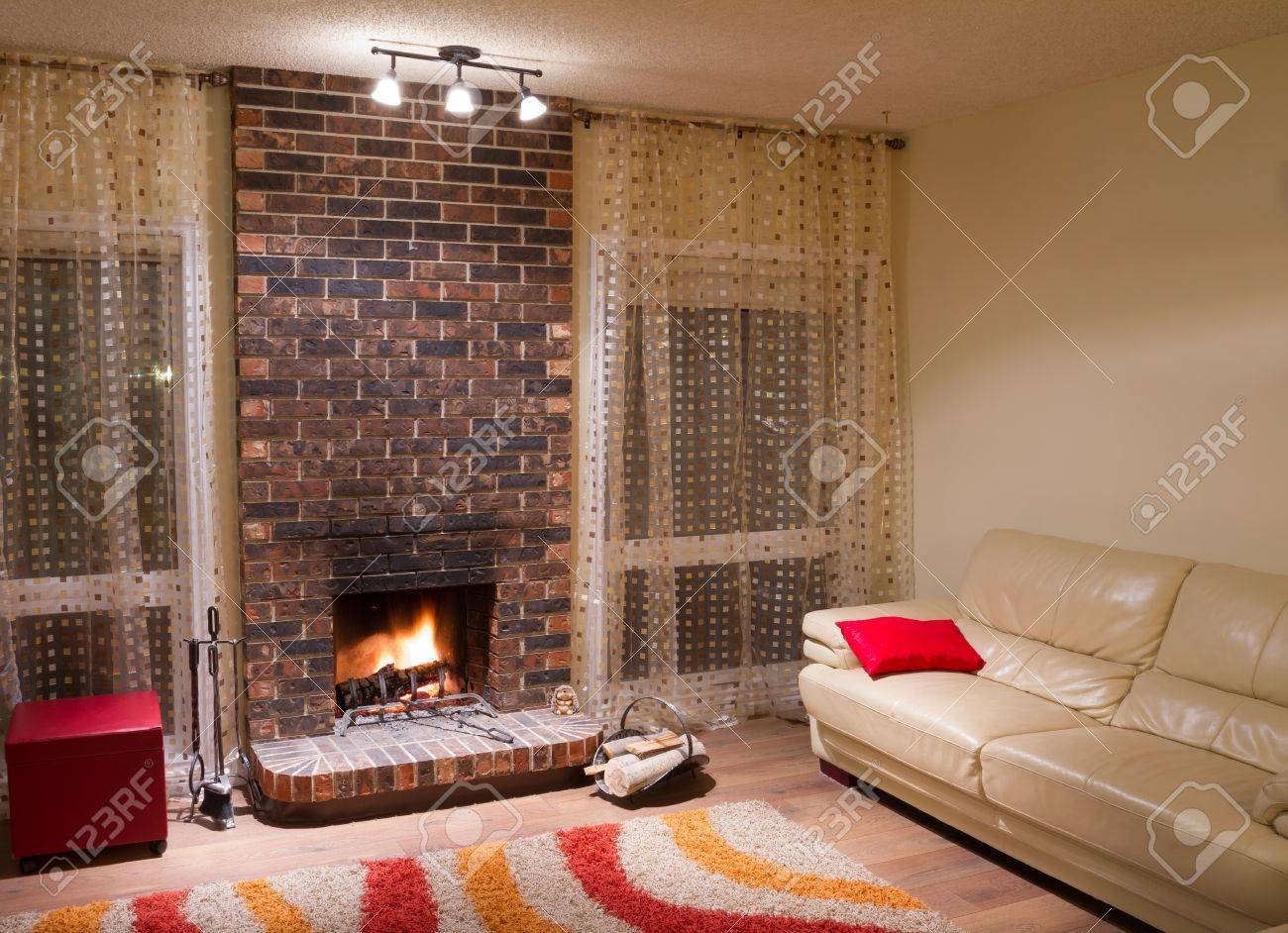 Interior design of living room in a new house with fireplace Stock Photo - 16126352