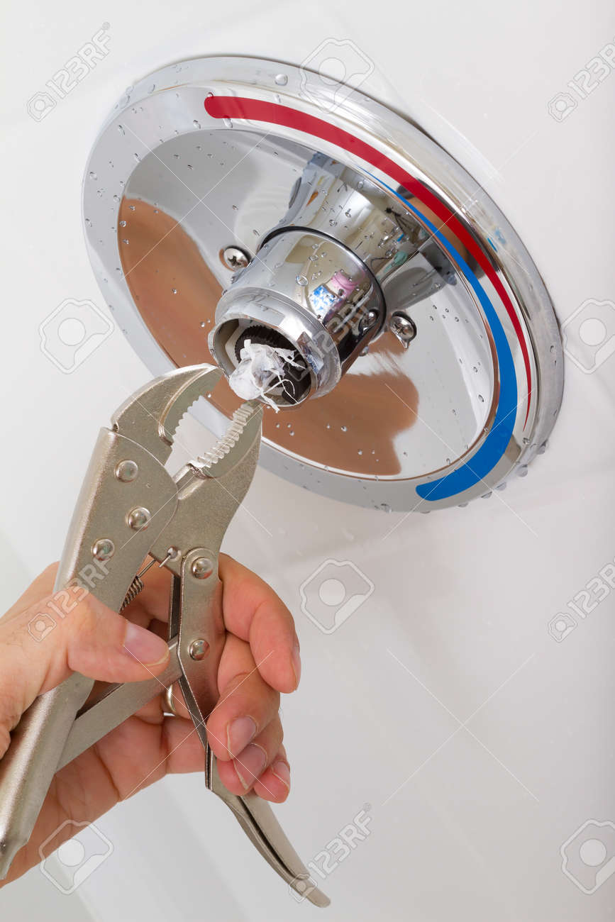 Fix Of Broken Shower Faucet Cold And Hot Water In The Bathroom Stock ...