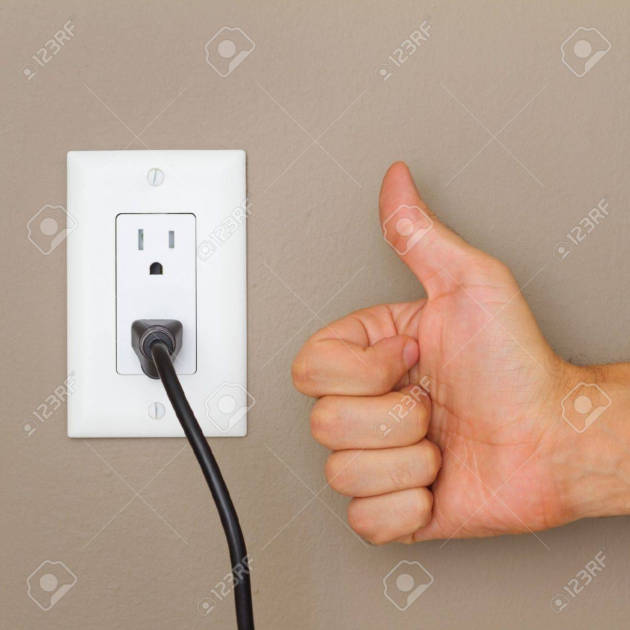 Thumbs Up, And Electric Cable In Electrical Outlet On The Wall ...