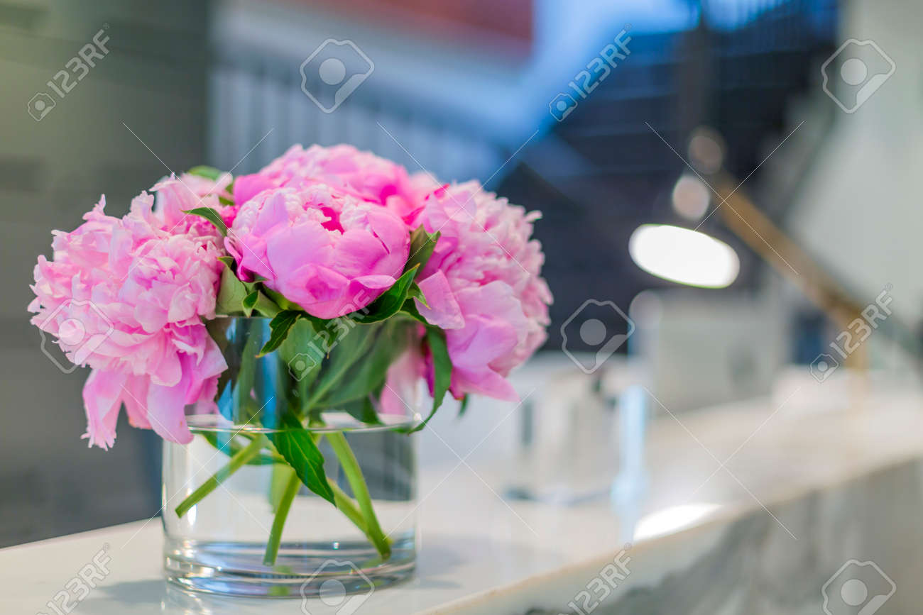 Interiors of a office medical reception with beautiful pink flowers interiors of a office medical reception with beautiful pink flowers in vase stock photo 42067513 mightylinksfo