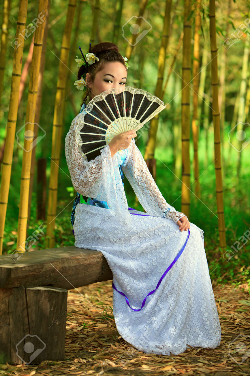 The young girl - the Japanese dressed in a kimono, is on the nature Stock Photo - 9416516