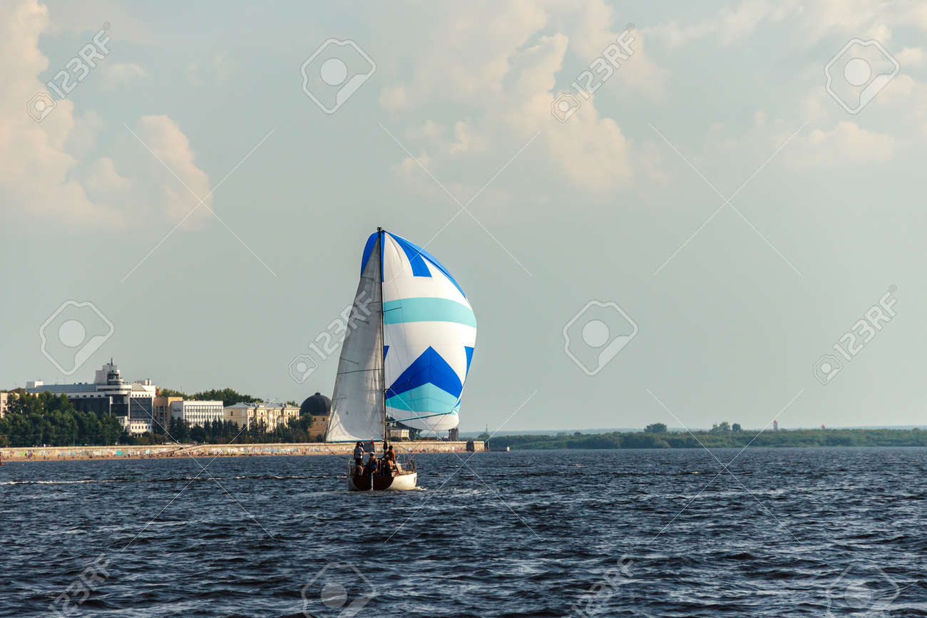 The yacht sails on the river Northern Dvina in the city of Arkhangelsk,