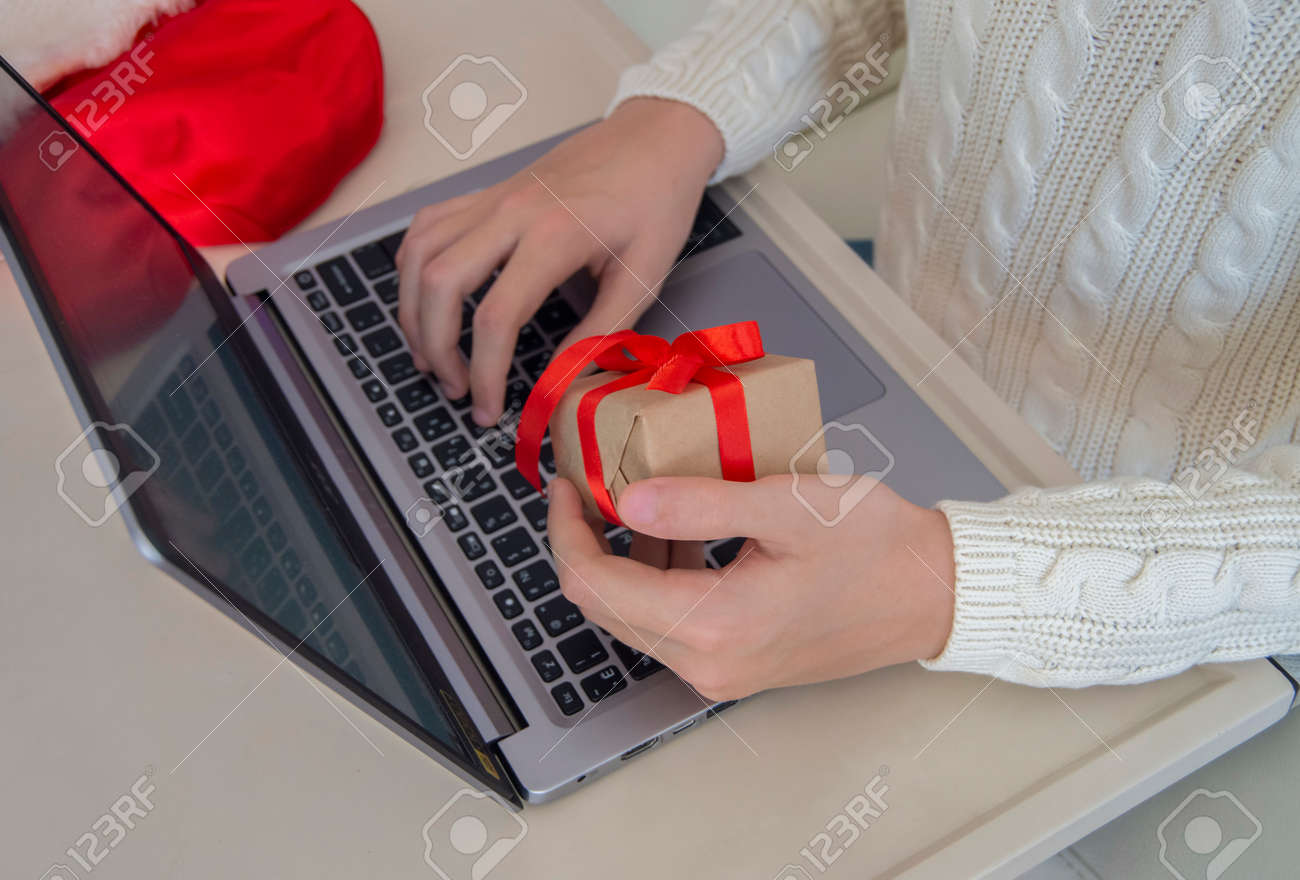 Online Shopping A Buyer Places An Order By Typing On A Laptop Stock Photo Picture And Royalty Free Image Image 157522787