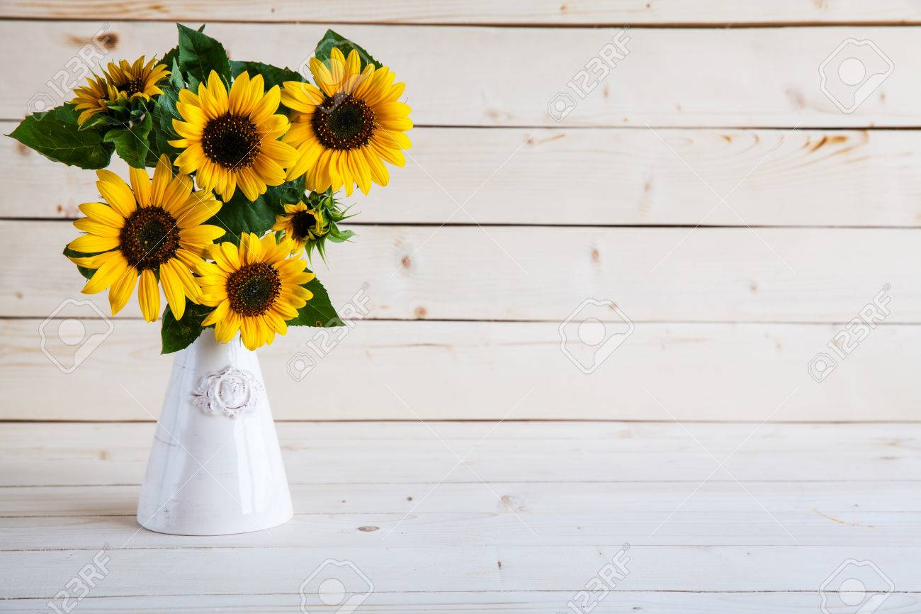 Sunflowers In A Vase On Rustic Gray Background Stock Photo