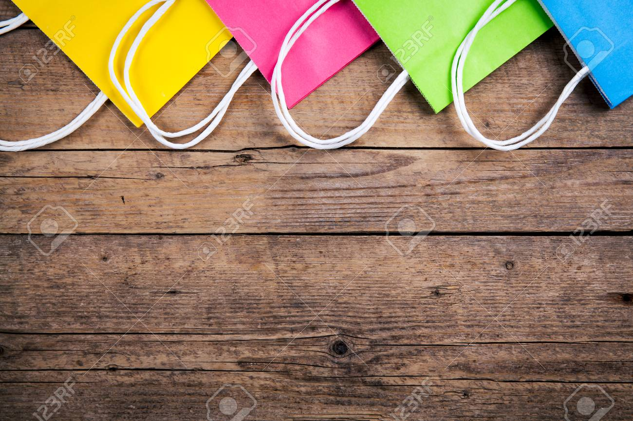 multicolored Shopping bags on a wooden background, sale, purchase - 51139441