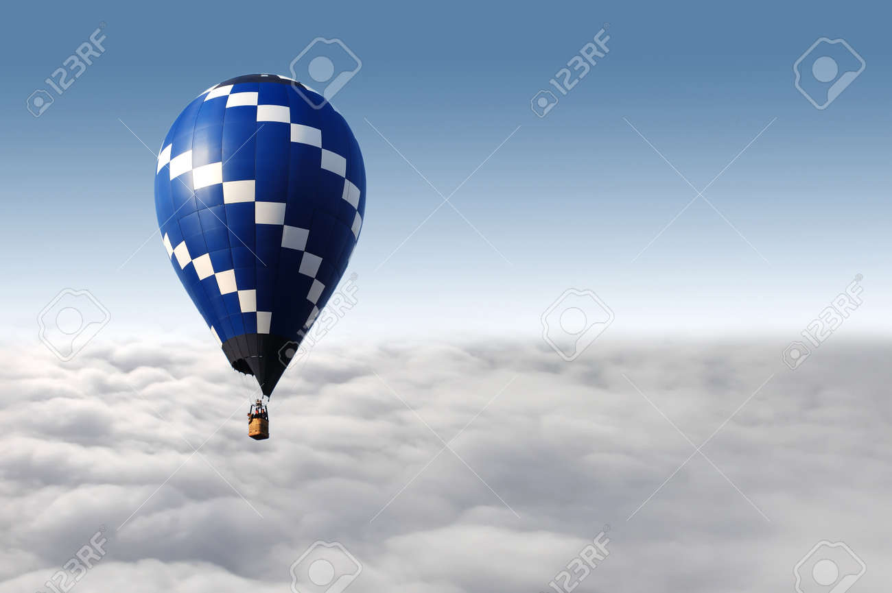 hot air balloon flying over the clouds Stock Photo - 12132614