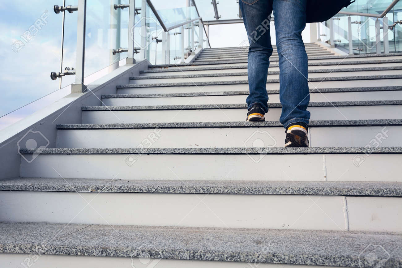 office stairs. man on office stairs and blue sky legs closeup stock photo 19046094
