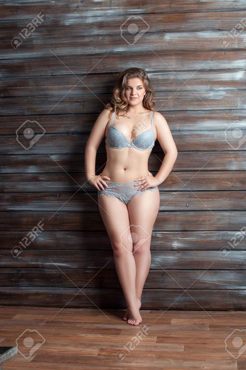 aae22c7cffd plus size model posing in lingerie an wall Stock Photo - 56382592