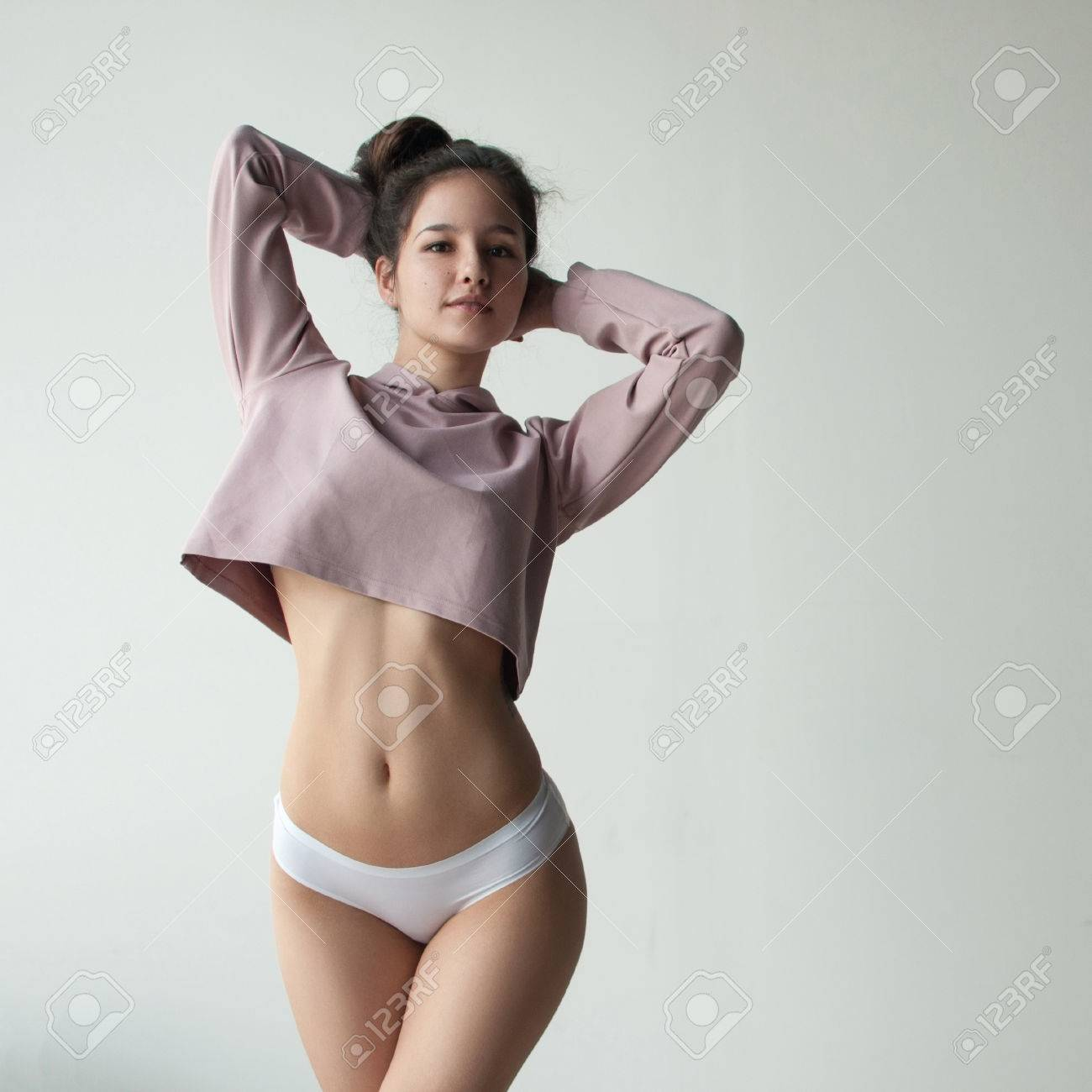 a3a51dba100022 pretty girl with cute face posing in crop top and white pantie in studio  Stock Photo