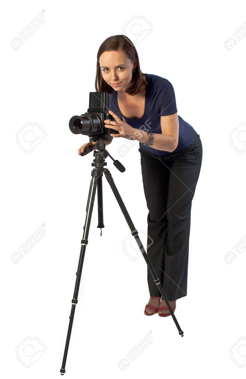 photo of beautiful girl working with big camera mounted on tripod. Isolation on the white Stock Photo - 6338312