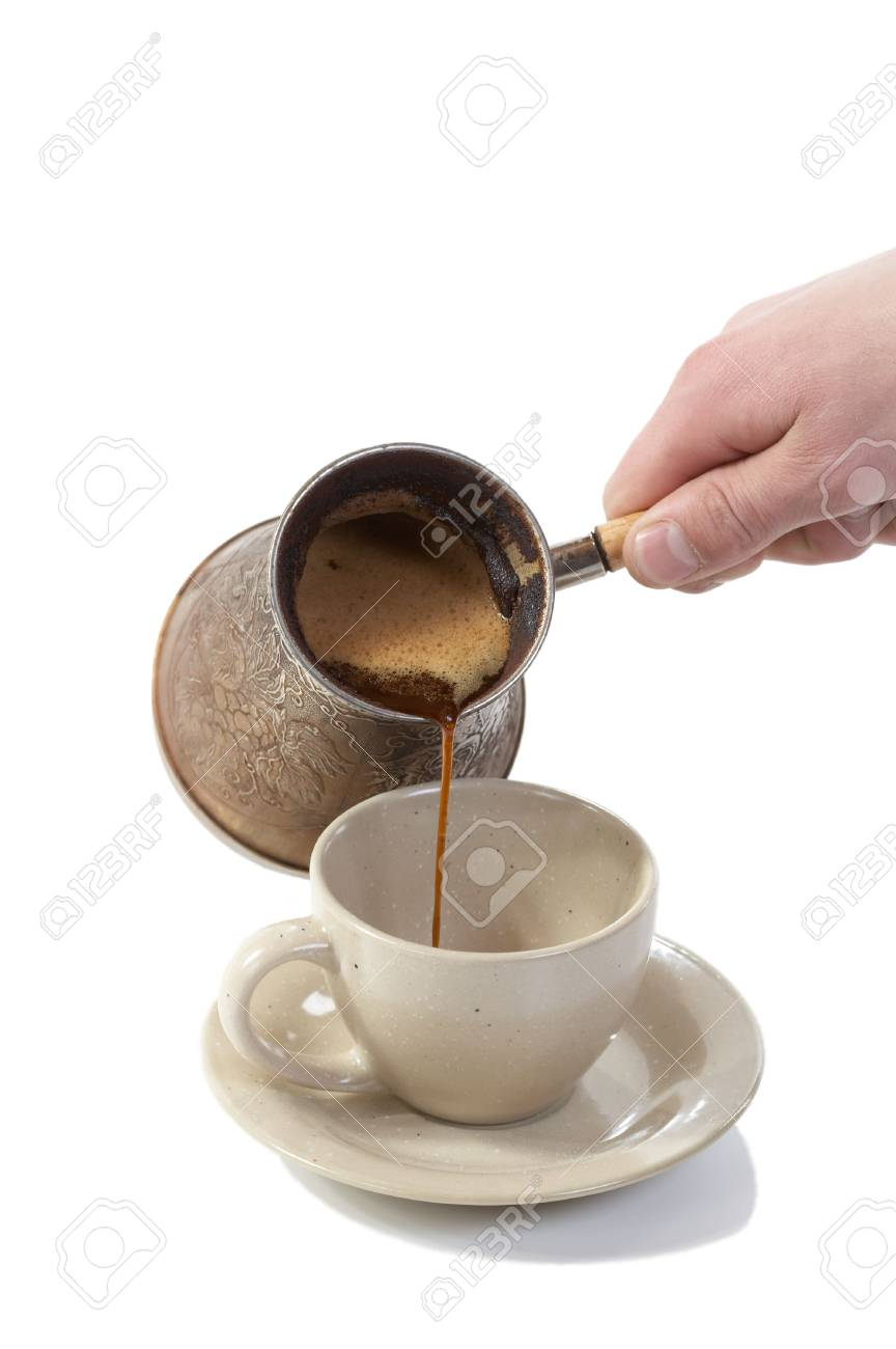 Coffee poured from coffee maker in cup on a white background Stock Photo - 4523862