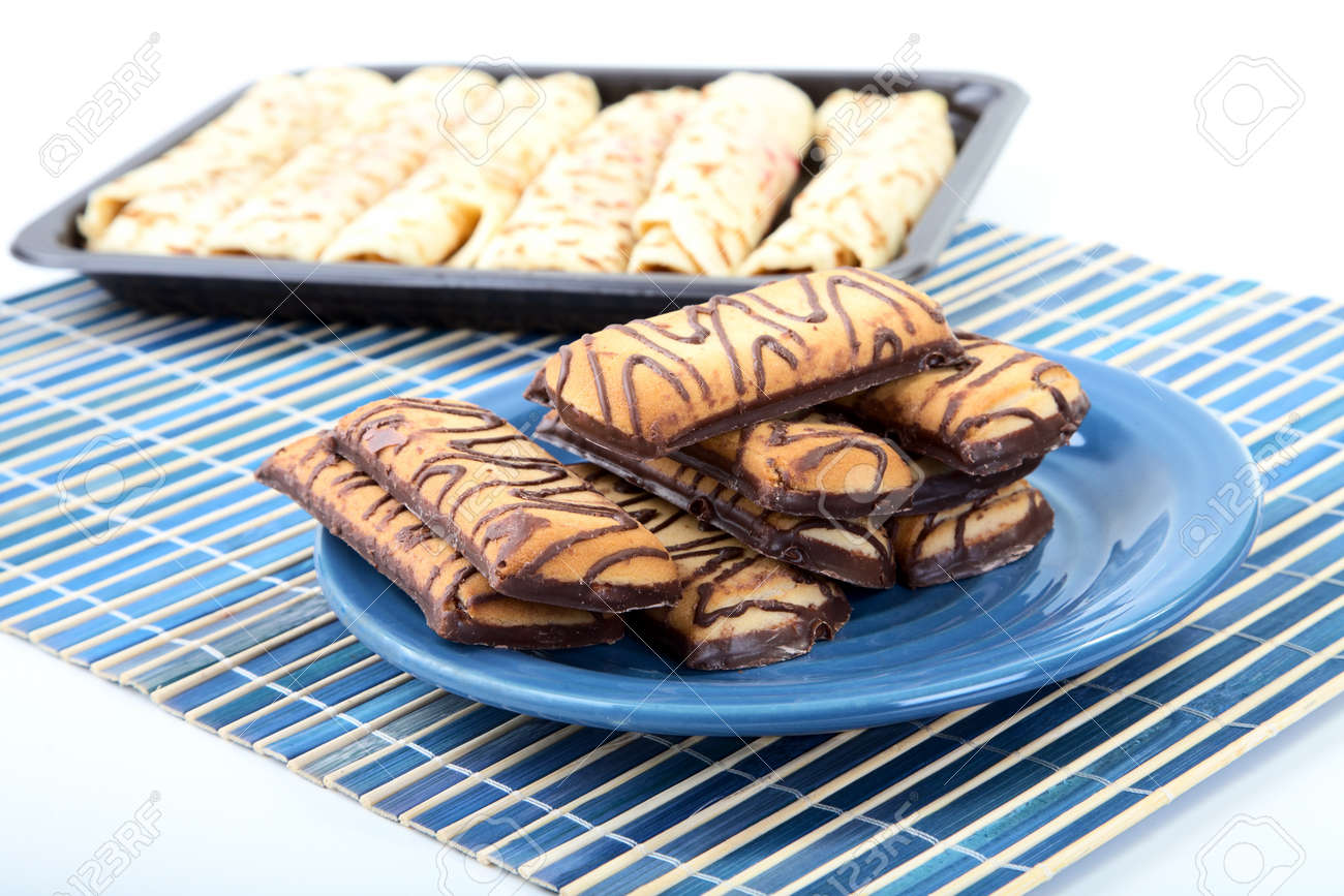 Chocolate cookies on a plate and pancakes with  stuffing Stock Photo - 11497102