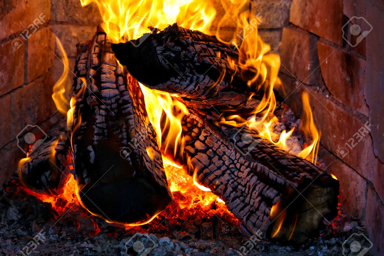 burning fire wood in a fireplace stock photo picture and royalty