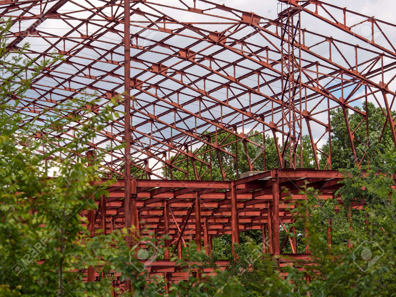 Construction of a huge red frame for a shopping center near the city. - 149743992