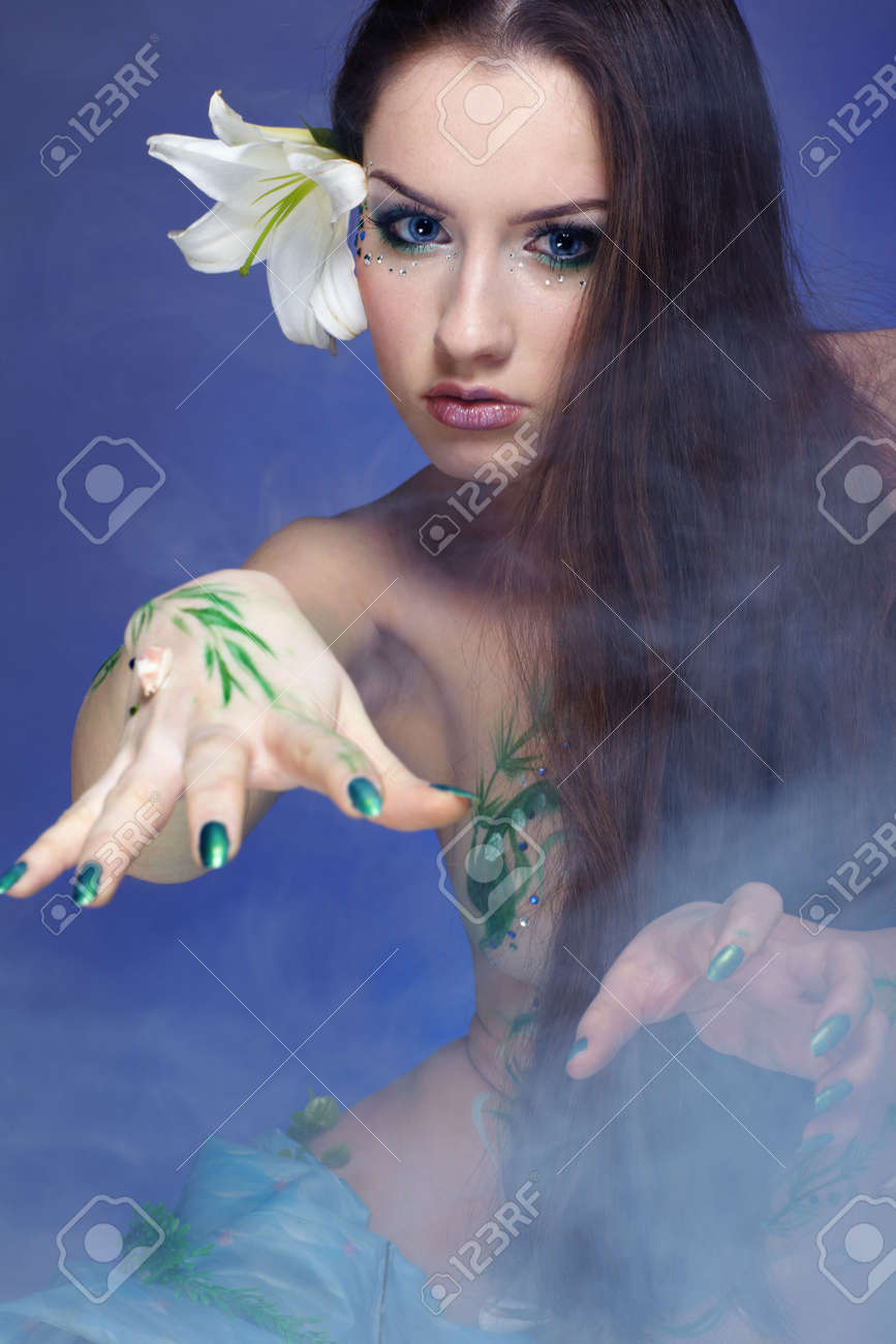portrait of beautiful girl with mermaid bodyart on blue Stock Photo - 4642468