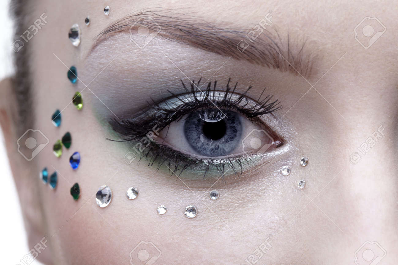 portrait of beautiful girl's eye zone with mermaid bodyart Stock Photo - 4642505