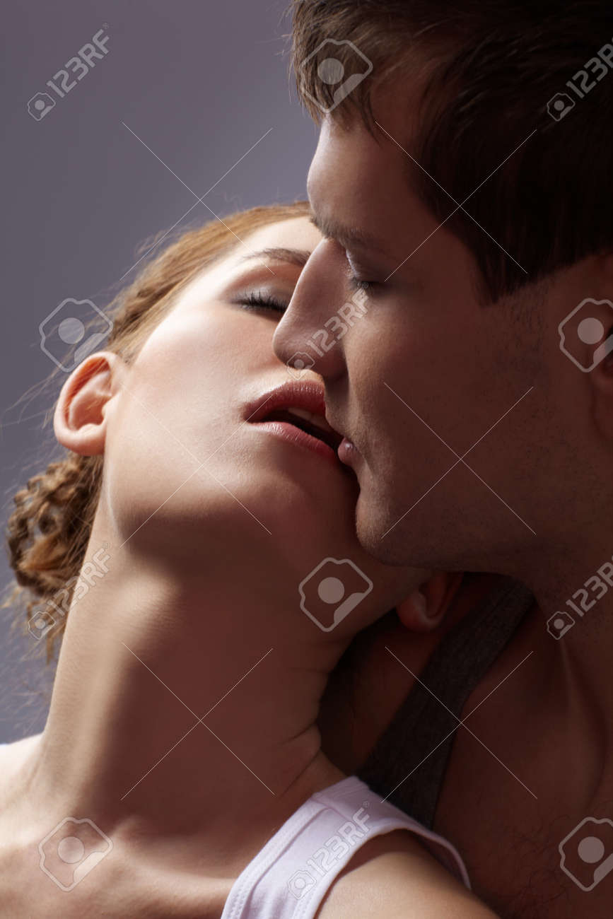 portrait of young caucasian couple on gray Stock Photo - 6517925
