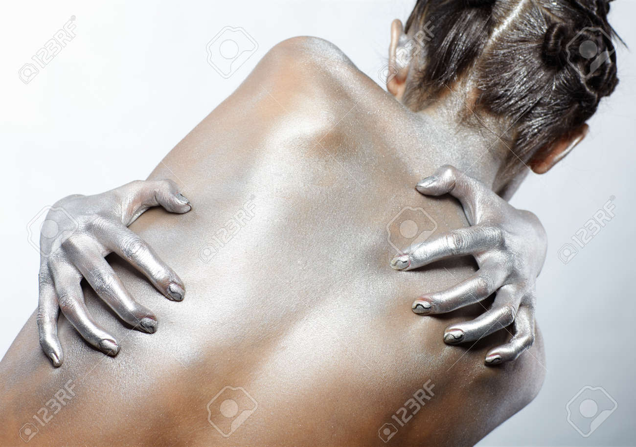 portrait of nude girl's back painted with silver Stock Photo - 7096056