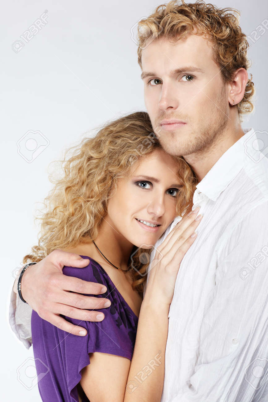 portrait of blonde curly couple on gray Stock Photo - 7112628