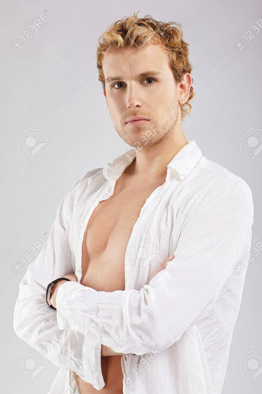 portrait of blonde man in white shirt posing on gray Stock Photo - 7112619