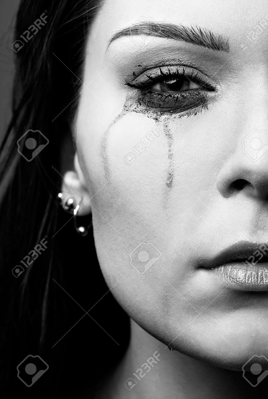close-up portrait of beautiful crying girl with smeared mascara Stock Photo - 7419208