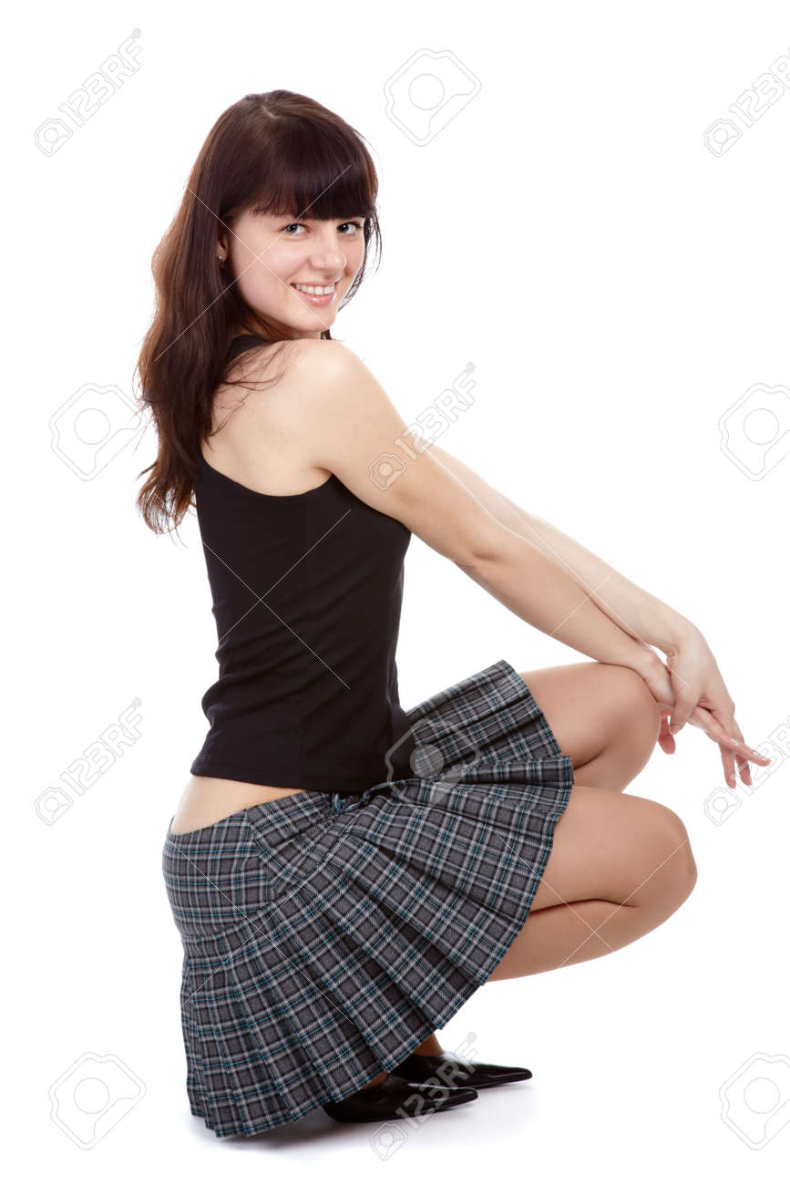 portrait of pretty slavonic girl in short checked gray skirt in court shoes Stock Photo - 7437474