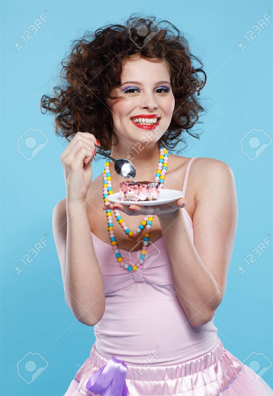portrait of beautiful curly brunette girl with cake Stock Photo - 7486441