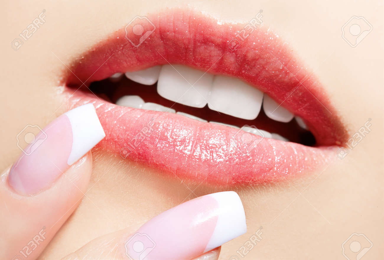 close-up portrait of beautiful girl's manicure and lips-zone make-up Stock Photo - 7767927
