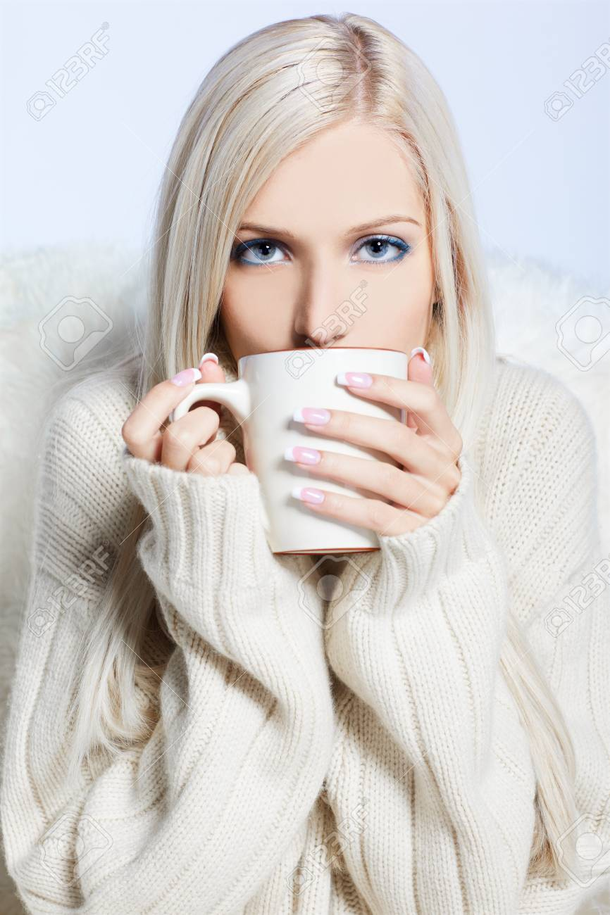 portrait of beautiful blonde with cup of hot drink Stock Photo - 7768001