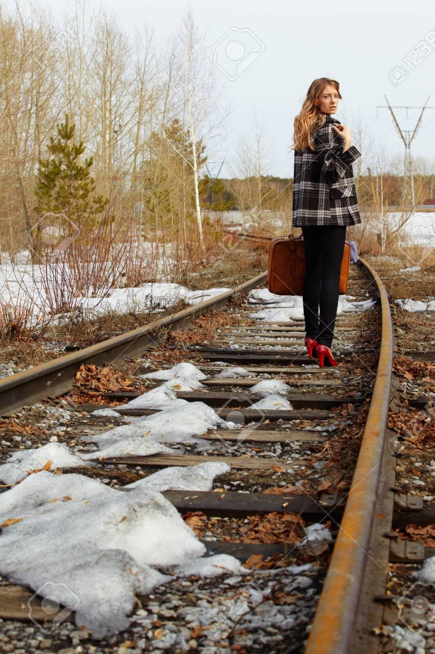 Girl walking along old railroad Stock Photo - 8039639