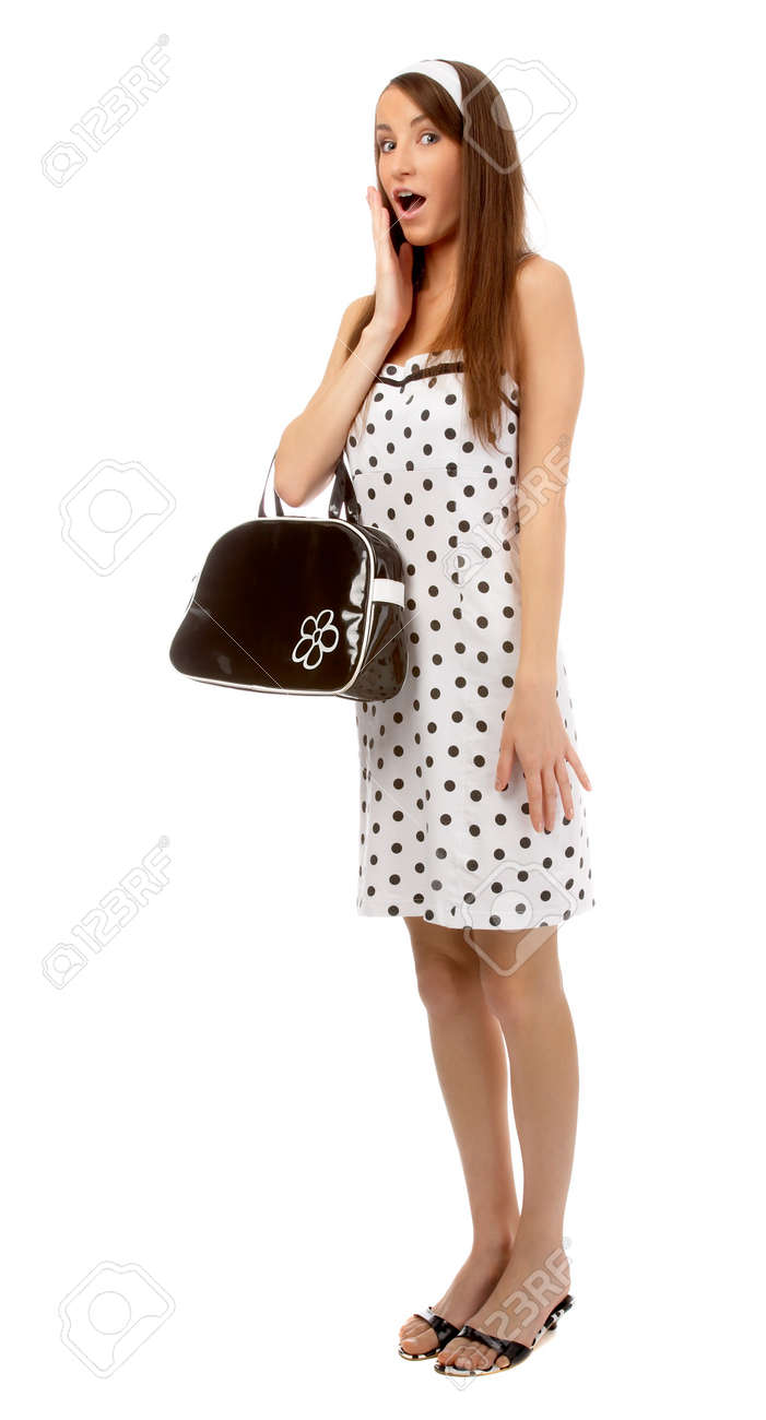 beautiful model poses in polka-dot dress with black bag looks shocked Stock Photo - 8147158