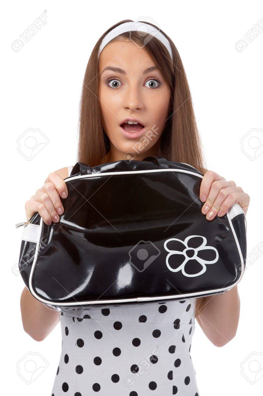 beautiful model poses in polka-dot dress holds black bag at her chest and looks shocked Stock Photo - 8147396