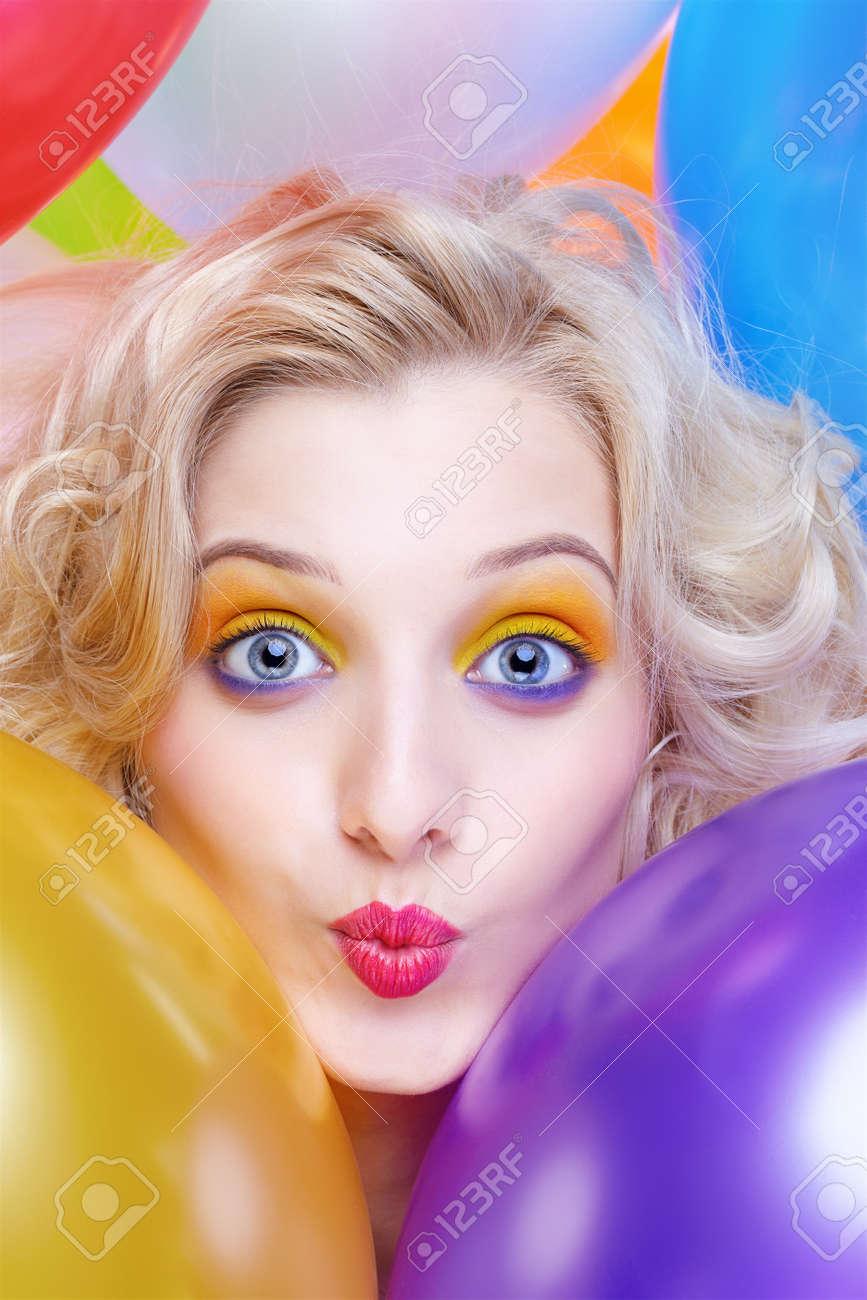 portrait of beautiful blonde girl with balloons celebrating birthday Stock Photo - 8540322