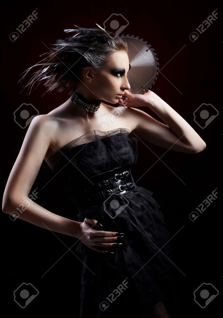 portrait of beautiful girl with bird of prey fantasy make-up with circular saw blade Stock Photo - 8558335