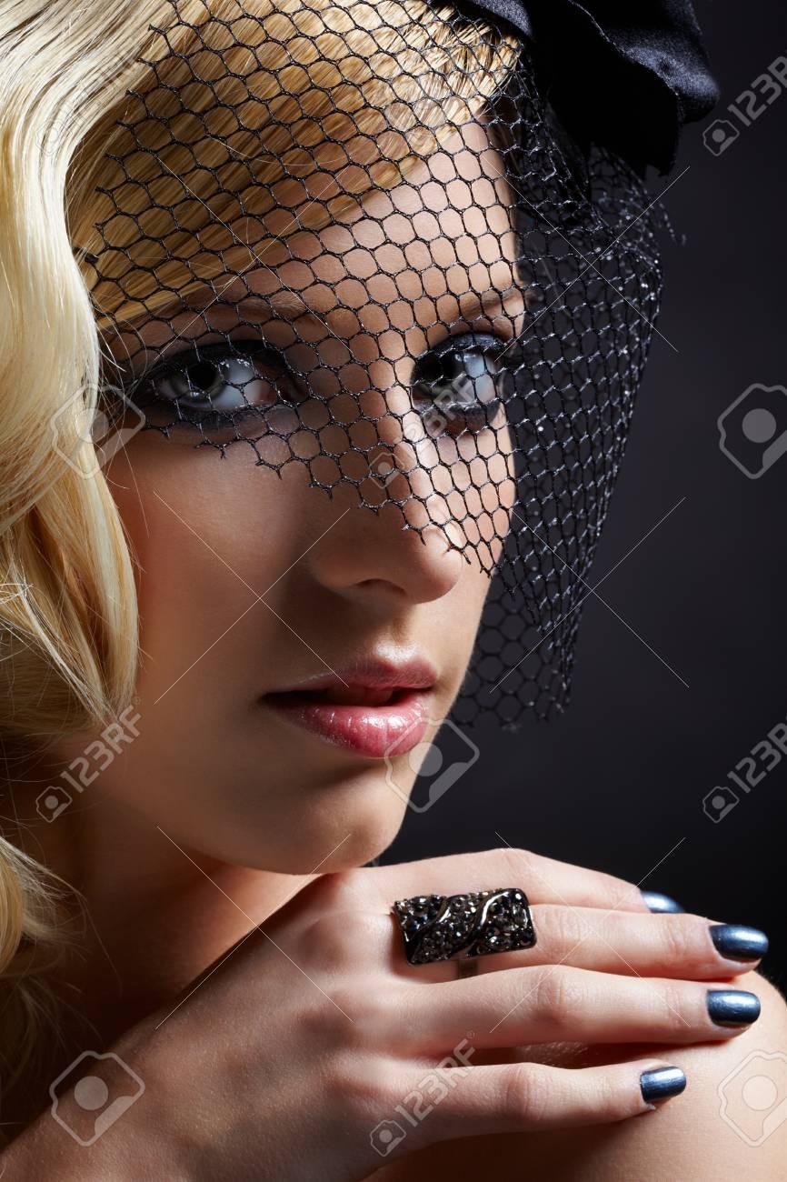 glamour portrait of beautiful blonde retro girl in veil on dark Stock Photo - 9154670