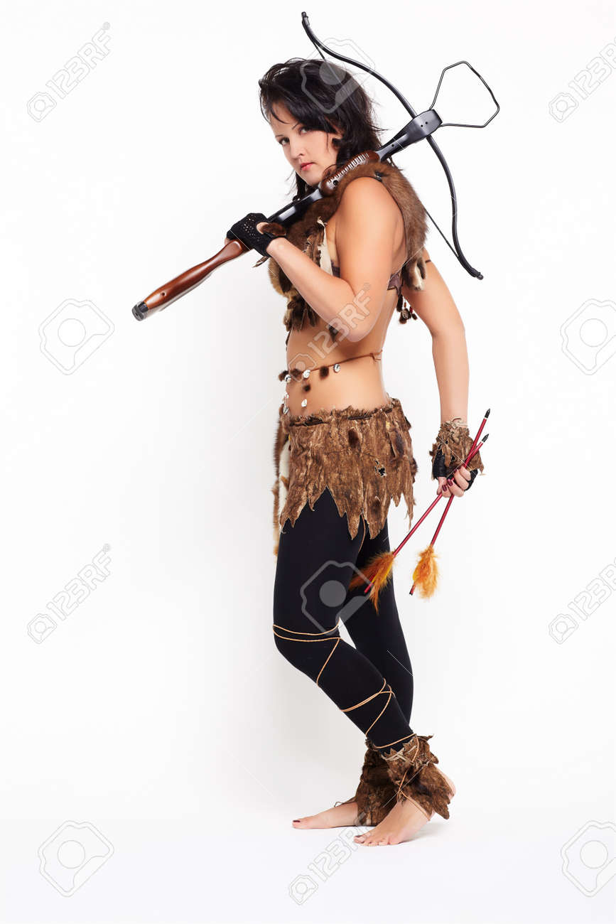 full-length portrait of beautiful woman fur hunter with crossbow on gray Stock Photo - 9971155