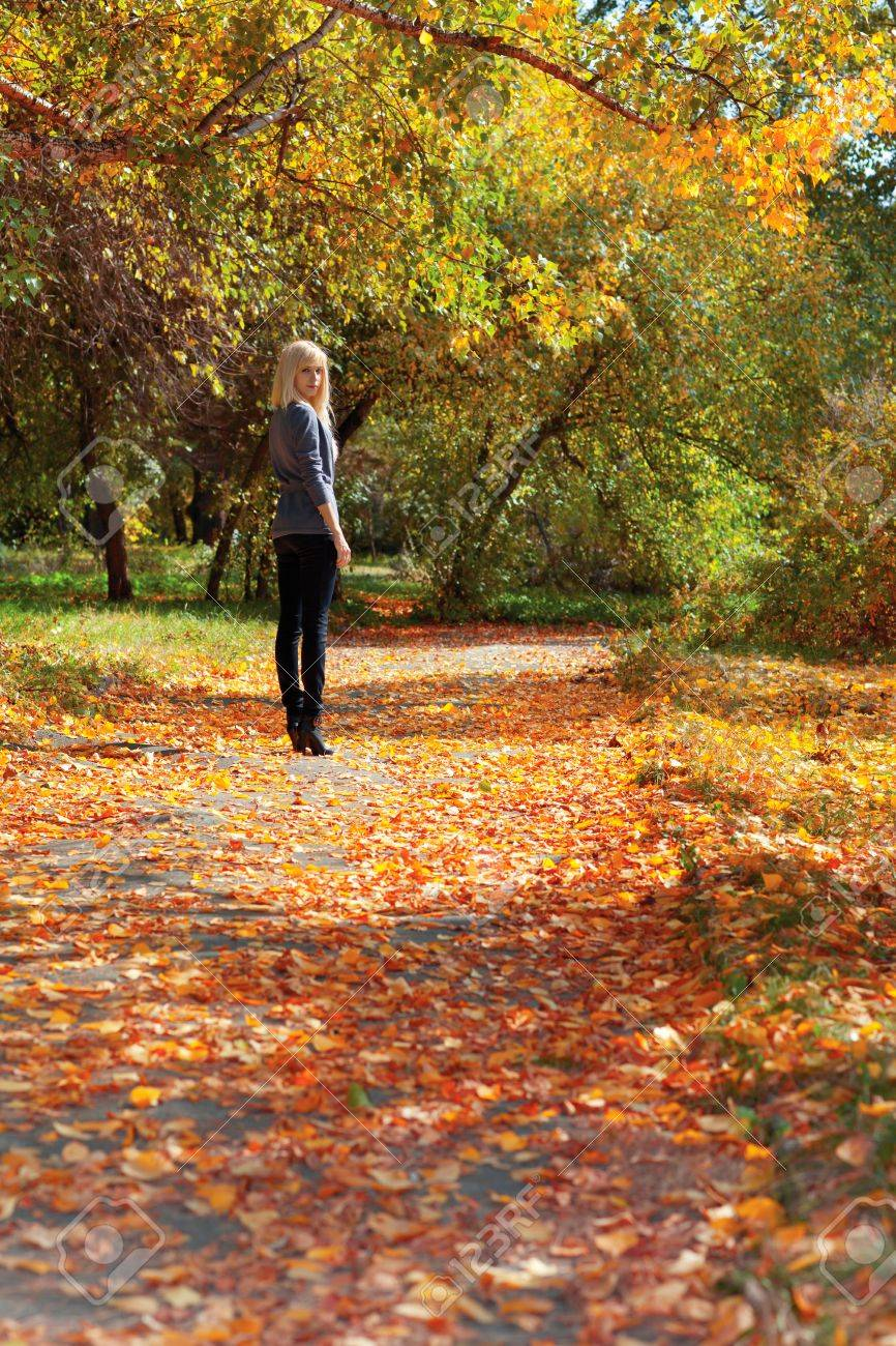 Young beautiful girl walking in autumn park Stock Photo - 11178479
