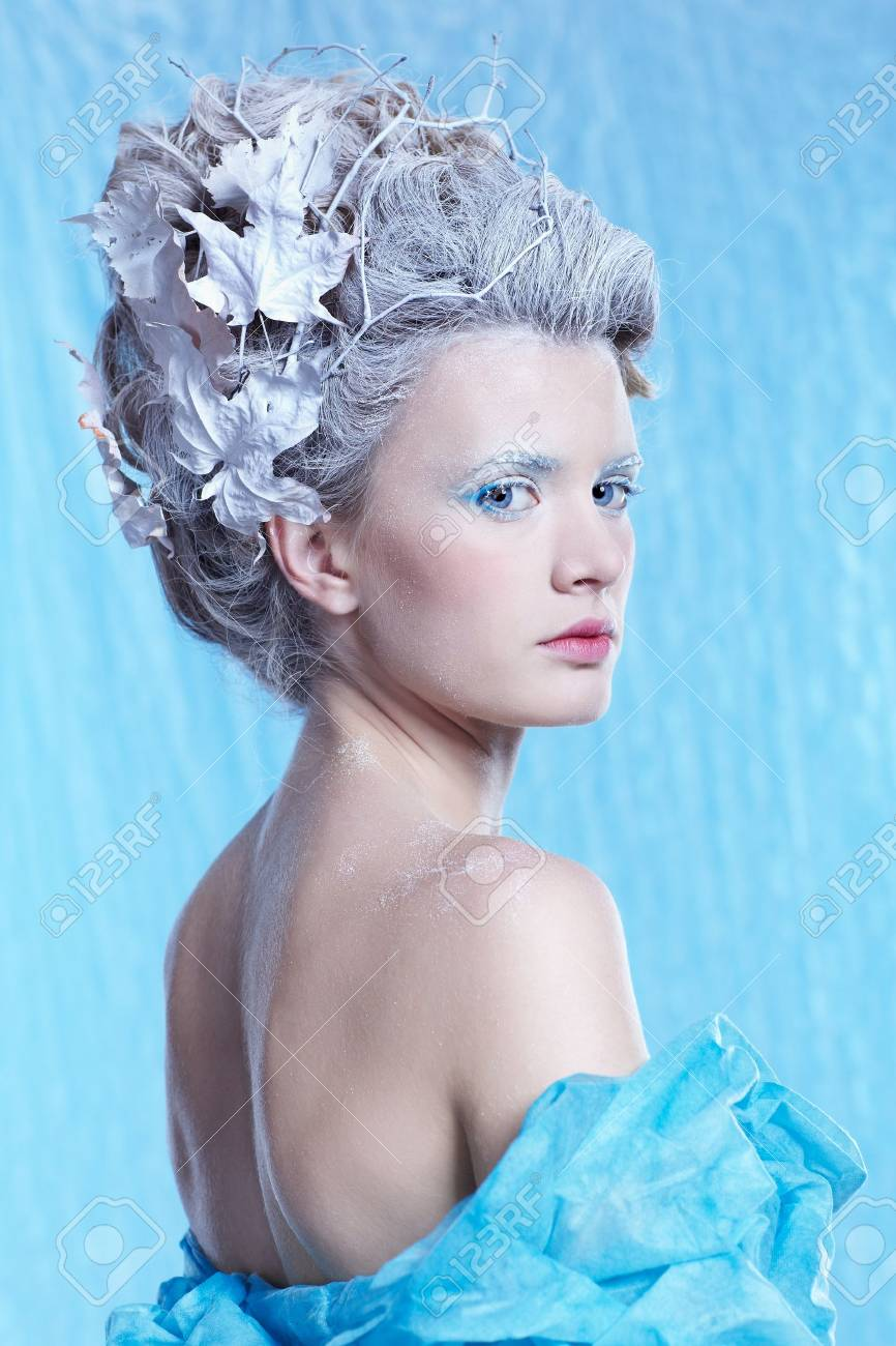 fantasy portrait of beautiful young woman imaging ice fairy on frozen blue Stock Photo - 11178609