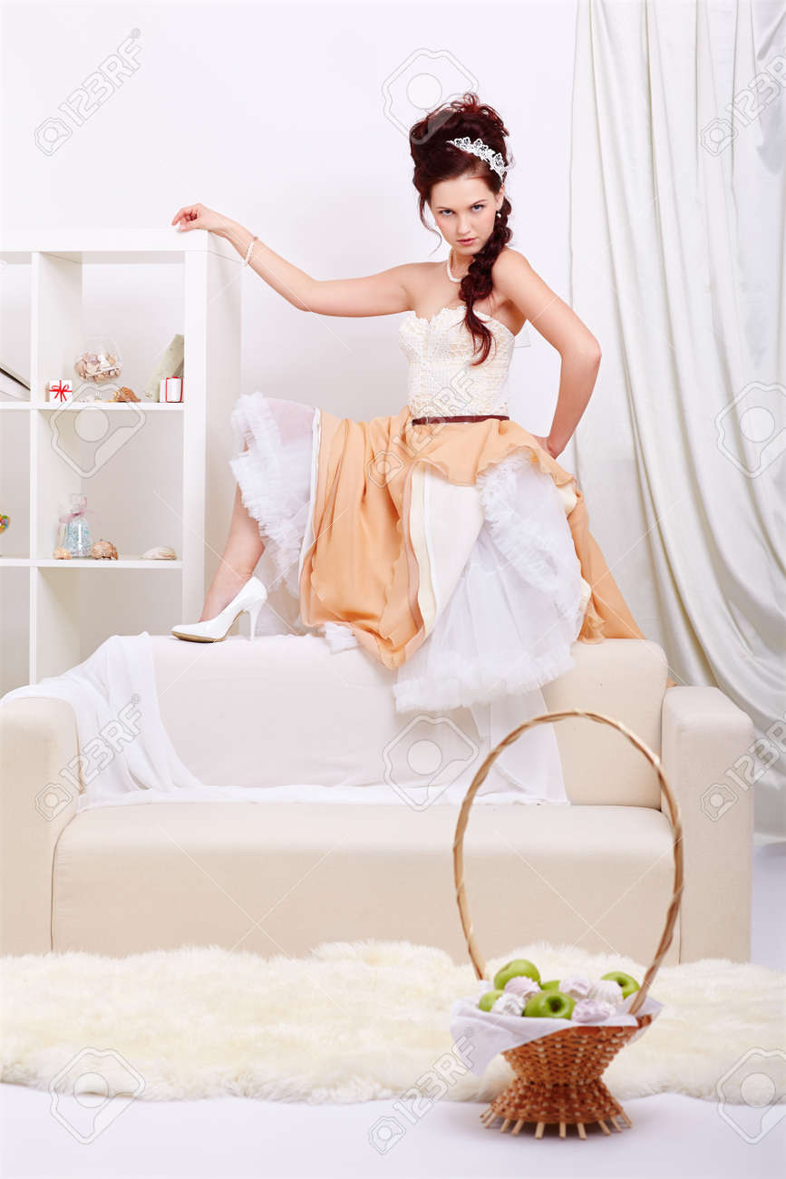portrait of young beautiful retro woman in vintage skirt with petticoat and corset on gray Stock Photo - 12341827