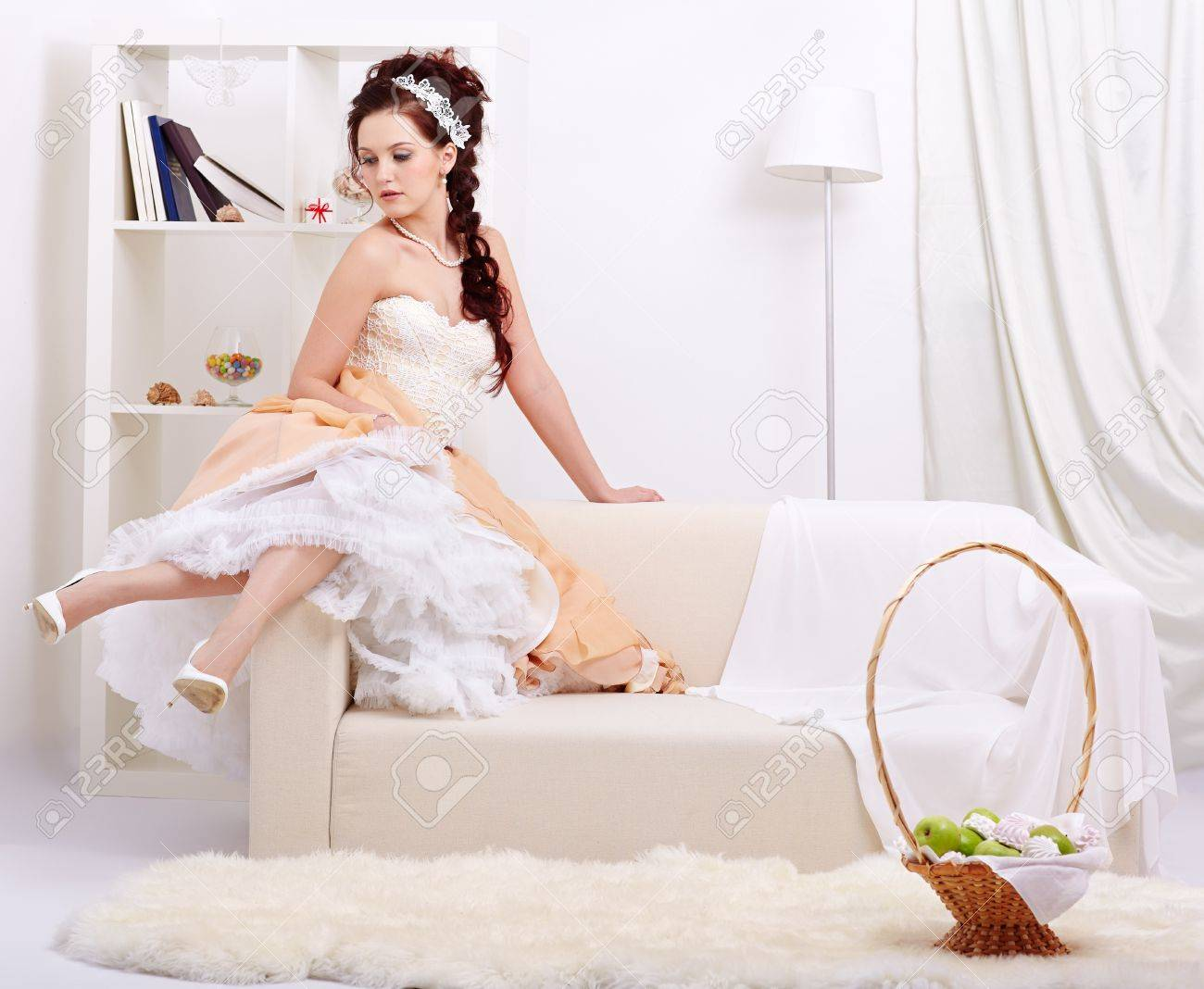 full-length portrait of young beautiful retro woman in vintage skirt with petticoat and corset on gray Stock Photo - 12341781