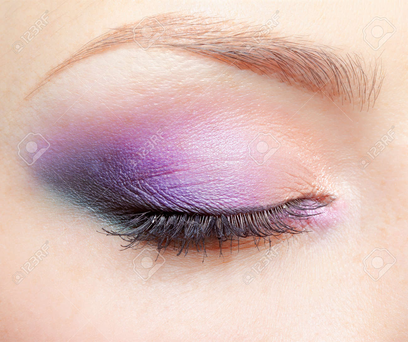 close-up portrait of young beautiful woman's eye zone make-up - 12341943
