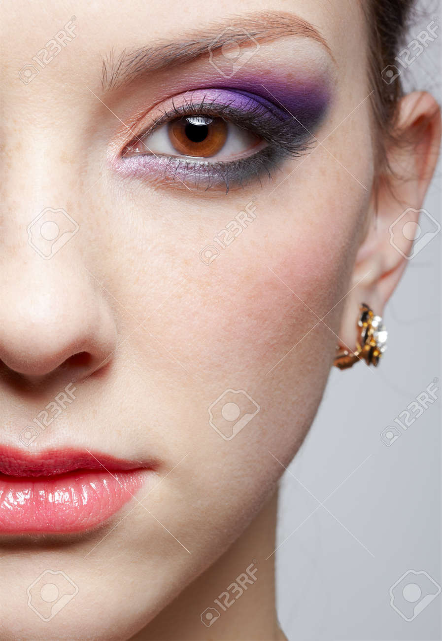 close-up half-face portrait of young beautiful woman with violet eye shadow - 12341948