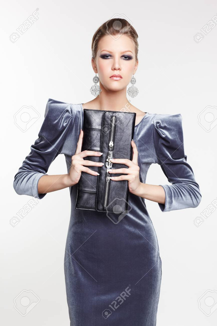 portrait of beautiful young brunette woman in fancy dress with clutch in hands Stock Photo - 13208646