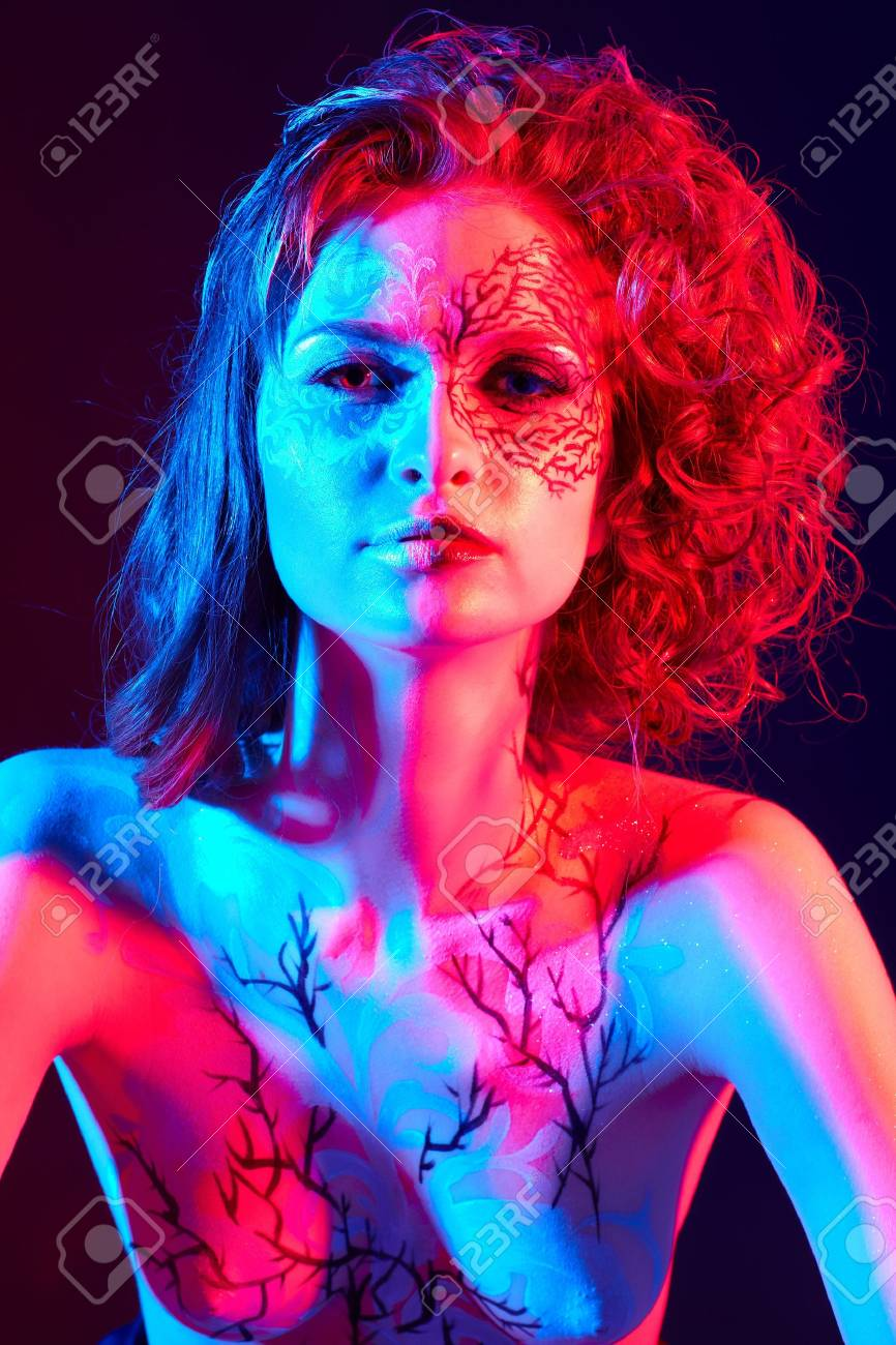 Portrait Of Beautiful Model With Skew Bodyart And Hairdo In Mixed Stock Photo Picture And Royalty Free Image Image 15785398